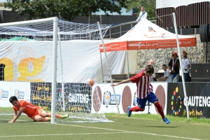 SOWETO, SOUTH AFRICA - MARCH 15: Oscar Clemente of Atletico Madrid celebrates with teammates after scoring against Shandong Luneng during Future Champions Gauteng on March 15, 2016 at Nike Centre Pimville in Soweto, South Africa.   (Photo by Ntombi Ntekele/Justus Media